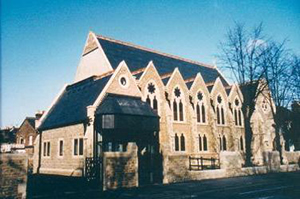 Church rebuilt without steeple, 1996